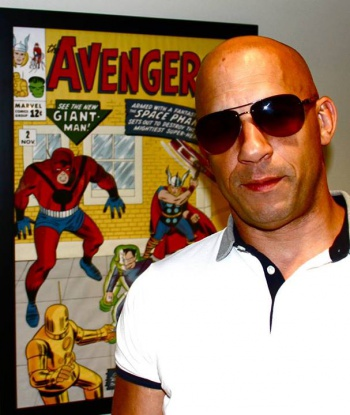 Vin Diesel next to Giant Man poster