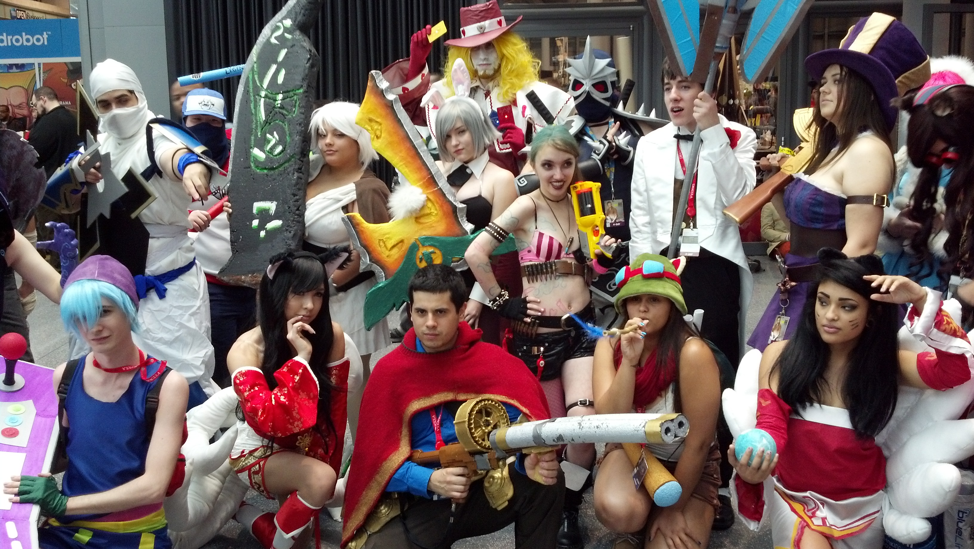 A large group of LoL cosplayers, all in one place.Shockblade Zed, TPA Shen, Riven, Battle Bunny Riven, Jack of Hearts Twisted Fate, Shen, Debonair Jayce, Caitlyn, Frostfire Annie, Ziggs, Crossplayed Arcade Sona, Ahri, Graves, Jinx, Teemo, Ahri