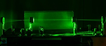 Lasers demonstrate the path of light as it goes through the invisibility cloak.
