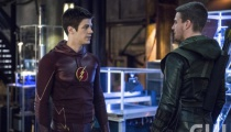 Grant Gustin as Barry Allen/The Flash and Stephen Amell as Oliver Queen/The Arrow. Photo Credit: Cate Cameron/The CW