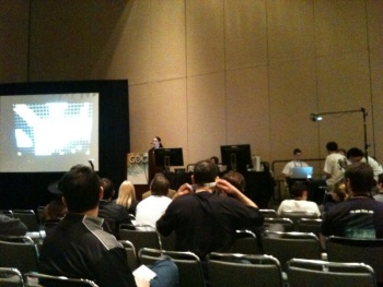 Kattan-Wright (center) speaking at GDC while the rest of the team (right) demonstrate playing D&D on the Surface.